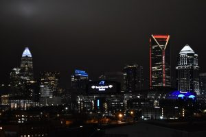 Charlotte, NC skyline with BOA stadium at night