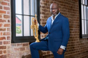 charlton singleton musician in a blue suit